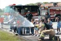 Children Spraying a Fire Hose